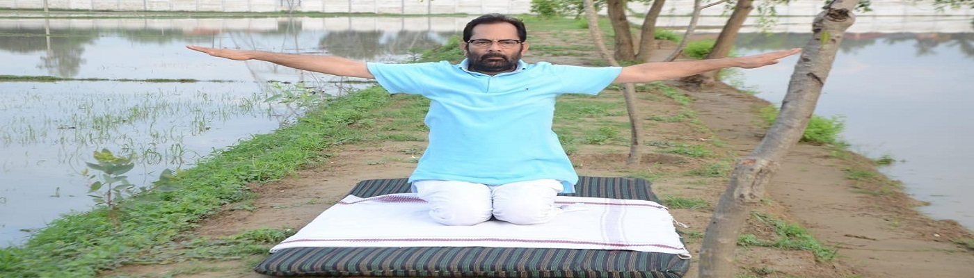 The Union Minister for Minority Affairs, Shri Mukhtar Abbas Naqvi performing Yoga, on the occasion of the 7th International Day of Yoga 2021, at Rampur, Uttar Pradesh on June 21, 2021.